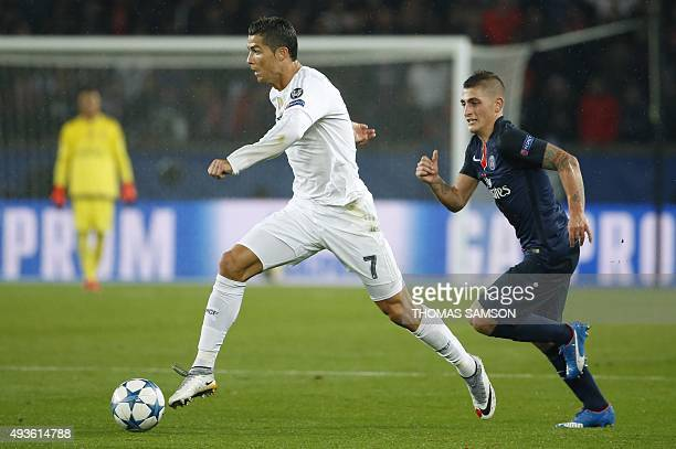 Real Madrid's Portuguese forward Cristiano Ronaldo vies with Paris SaintGermain's Italian midfielder Marco Verratti during the UEFA Champions League...