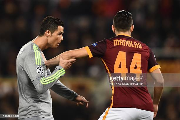Real Madrid's Portuguese forward Cristiano Ronaldo vies with Roma's defender from Greece Konstas Manolas during the UEFA Champions League football...