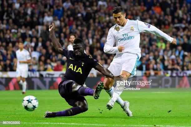 Real Madrid's Portuguese forward Cristiano Ronaldo vies with Tottenham Hotspur's Colombian defender Davinson Sanchez during the UEFA Champions League...
