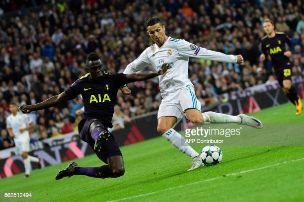 TOPSHOT Real Madrid's Portuguese forward Cristiano Ronaldo vies with Tottenham Hotspur's Colombian defender Davinson Sanchez during the UEFA...