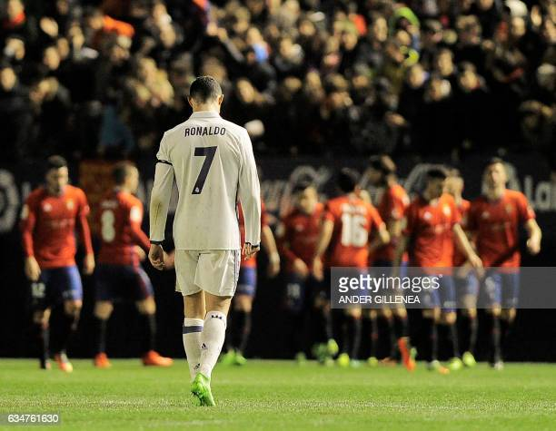 TOPSHOT Real Madrid's Portuguese forward Cristiano Ronaldo walks after a goal by Osasuna during the Spanish league football match CA Osasuna vs Real...
