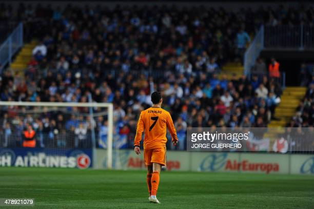 Real Madrid's Portuguese forward Cristiano Ronaldo walks on the pitch after scoring the Spanish league football match Malaga CF vs Real Madrid CF at...