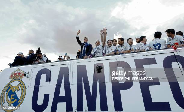 Real Madrid's Portuguese forward Cristiano Ronaldo waves from a bus celebrating the team's win on Plaza Cibeles in Madrid on June 4 2017 after the...