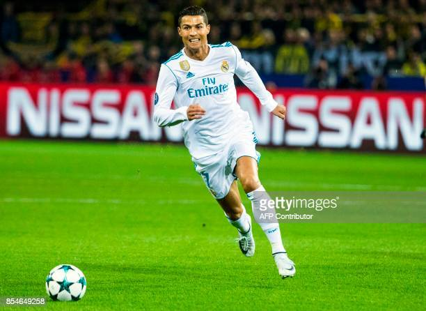 Real Madrid's Portuguese forward Ronaldo runs with the ball during the UEFA Champions League Group H football match BVB Borussia Dortmund v Real...