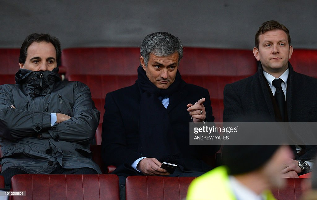 "Real Madrid's Portuguese manager Jose Mourinho (C) gestures from the stands before the English Premier League football match between Manchester United and Everton at Old Trafford, Manchester, North West England, on February 10, 2013. Real Madrid will face Manchester United at home in Spain on February 13 in the last 16 of the UEFA Champions League. USE. No use with unauthorized audio, video, data, fixture lists, club/league logos or ""live"" services. Online in-match use limited to 45 images, no video emulation. No use in betting, games or single club/league/player publications."