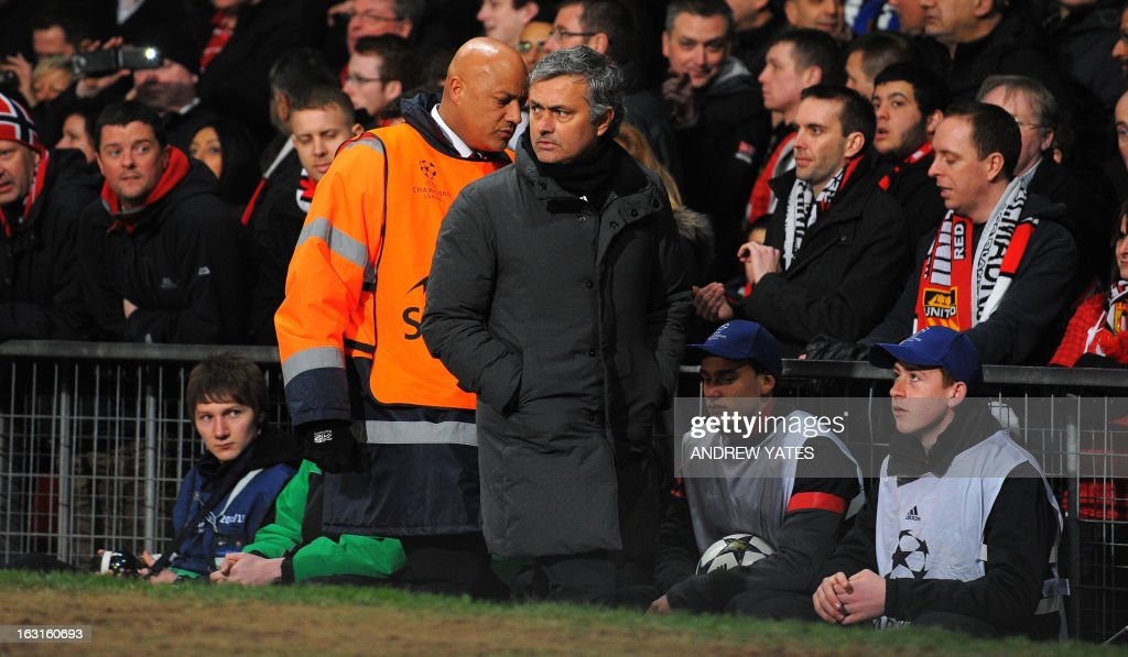 Real Madrid's Portuguese manager Jose Mourinho leaves the field at half time during the UEFA Champions League round of 16 second leg football match between Manchester United and Real Madrid at Old Trafford in Manchester, northwest England on March 5, 2013. AFP PHOTO / ANDREW YATES