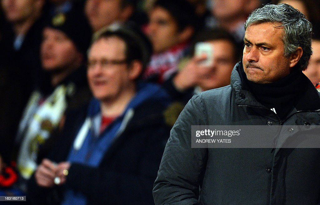 Real Madrid's Portuguese manager Jose Mourinho leaves the field at half time during the UEFA Champions League round of 16 second leg football match between Manchester United and Real Madrid at Old Trafford in Manchester, northwest England on March 5, 2013.