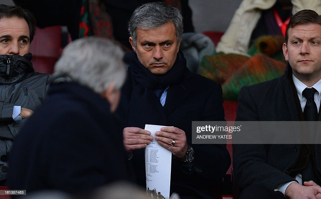 "Real Madrid's Portuguese manager Jose Mourinho sits in the stands before the English Premier League football match between Manchester United and Everton at Old Trafford, Manchester, North West England, on February 10, 2013. Real Madrid will face Manchester United at home in Spain on February 13 in the last 16 of the UEFA Champions League. USE. No use with unauthorized audio, video, data, fixture lists, club/league logos or ""live"" services. Online in-match use limited to 45 images, no video emulation. No use in betting, games or single club/league/player publications."