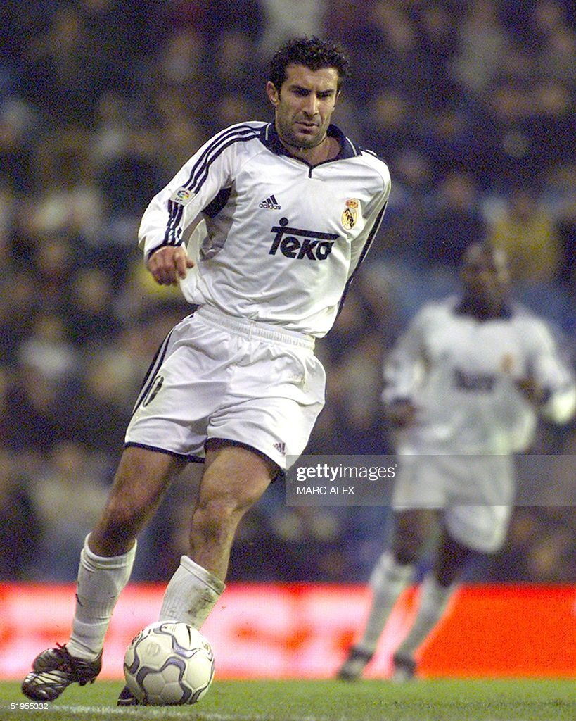 Real Madrid s Portuguese midfielder Luis Figo drib