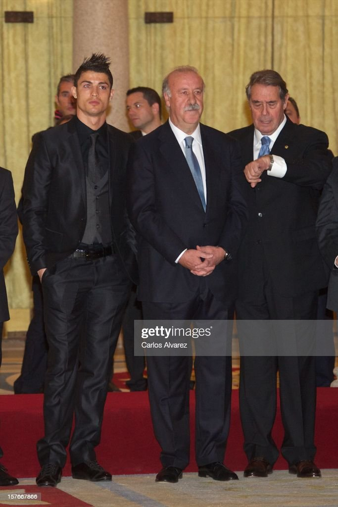 Real Madrid's Portuguese player Cristiano Ronaldo (L) and Spain's national football team coach Vicente Del Bosque (C) attend the National Sports Awards ceremony at El Pardo Palace on December 5, 2012 in Madrid, Spain.