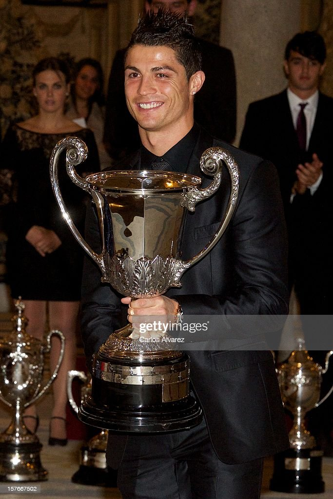 Real Madrid's Portuguese player <a gi-track='captionPersonalityLinkClicked' href=/galleries/search?phrase=Cristiano+Ronaldo+-+Soccer+Player&family=editorial&specificpeople=162689 ng-click='$event.stopPropagation()'>Cristiano Ronaldo</a> poses with his Ibero-American Community Trophy during the National Sports Awards ceremony at El Pardo Palace on December 5, 2012 in Madrid, Spain.