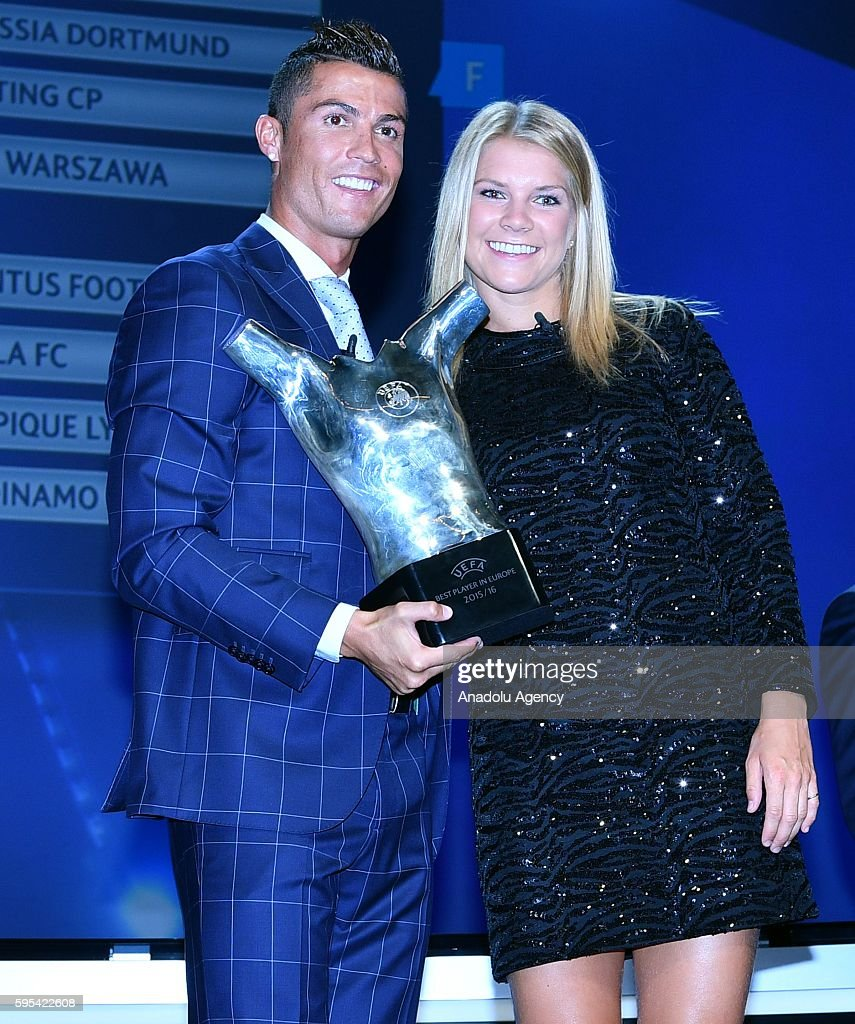 Real Madrid's Portuguese player Cristiano Ronaldo poses with Lyon's Norwegian forward Ada Hegerberg at the end of the UEFA Champions League Group...
