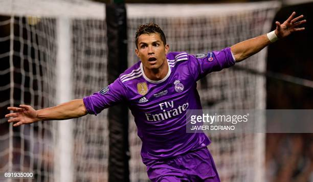 Real Madrid's Portuguese striker Cristiano Ronaldo celebrates after scoring their third goal during the UEFA Champions League final football match...