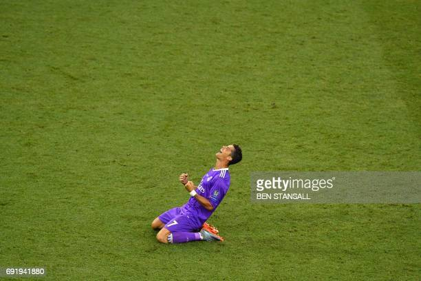 Real Madrid's Portuguese striker Cristiano Ronaldo celebrates after winning the UEFA Champions League final football match between Juventus and Real...