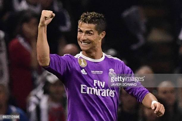 Real Madrid's Portuguese striker Cristiano Ronaldo celebrates after scoring the opening goal of the UEFA Champions League final football match...