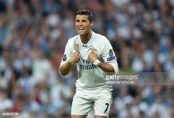 TOPSHOT Real Madrid's Portuguese striker Cristiano Ronaldo gestures during the UEFA Champions League quarterfinal second leg football match Real...
