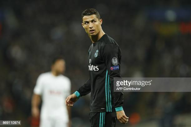 Real Madrid's Portuguese striker Cristiano Ronaldo reacts after Tottenham scored their third goal during the UEFA Champions League Group H football...