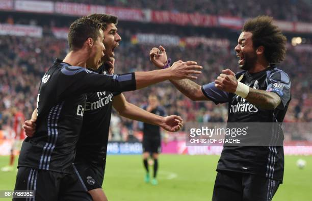 Real Madrid's Portuguese striker Cristiano Ronaldo Real MadridÕs midfielder Marco Asensio and Real Madrid's Brazilian defender Marcelo celebrate...