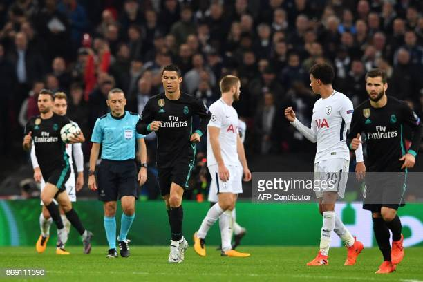 Real Madrid's Portuguese striker Cristiano Ronaldo runs back after scoring their first goal during the UEFA Champions League Group H football match...