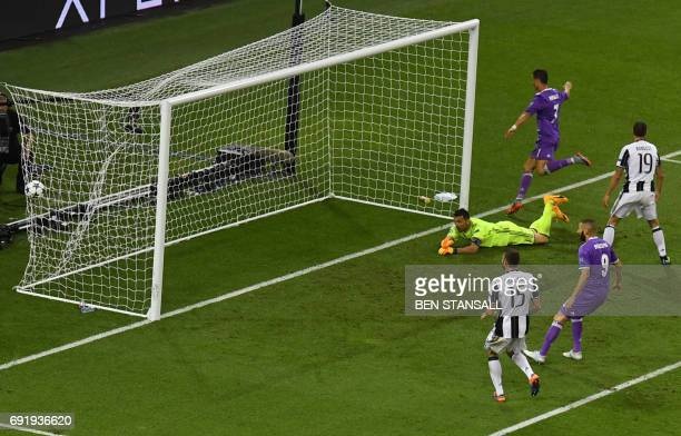 Real Madrid's Portuguese striker Cristiano Ronaldo scores a goal during the UEFA Champions League final football match between Juventus and Real...