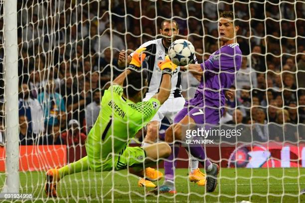 TOPSHOT Real Madrid's Portuguese striker Cristiano Ronaldo shoots over Juventus' Italian goalkeeper Gianluigi Buffon to score their third goal during...
