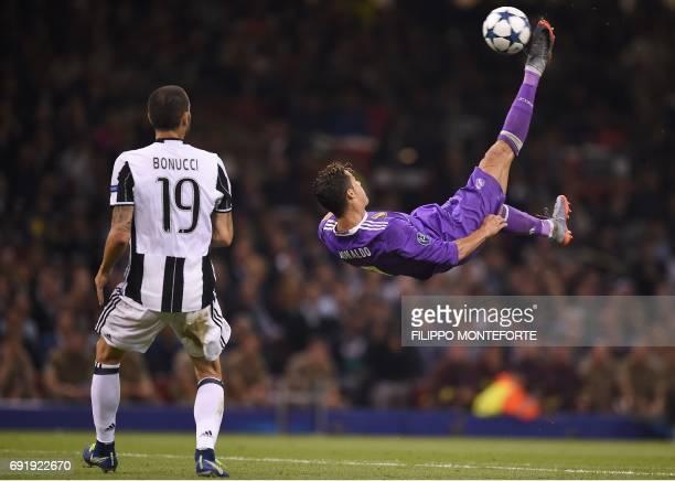 TOPSHOT Real Madrid's Portuguese striker Cristiano Ronaldo tries for an overhead kick by Juventus' Italian defender Leonardo Bonucci during the UEFA...