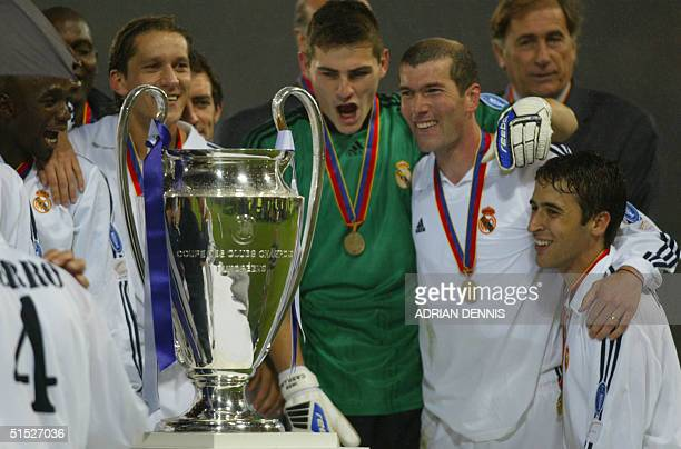 Real Madrid's Raul Gonzalez and Zinedine Zindane Dominguez Cesar celebrate there victory after the Champions League final opposing Real Madrid to...