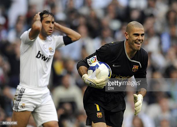 Real Madrid's Raul Gonzalez gestures next to Barcelona's goalkeeper Victor Valdes during a Spanish league football match at the Santiago Bernabeu...