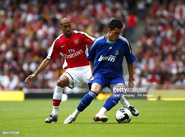 Real Madrid's Rayco Garcia Dauta and Arsenal's Gael Clichy battle for the ball