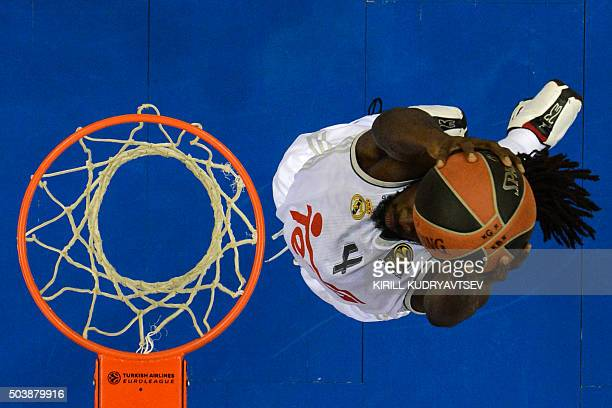 Real Madrid's Senegalese forward Maurice Ndour jumps to the basket with the ball during the Euroleague Top 16 group F basketball match between CSKA...