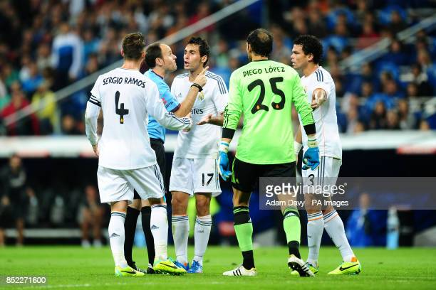 Real Madrid's Sergio Ramos Alvaro Arbeloa goalkeeper Diego Lopez and Pepe surround referee Mateu Lahoz