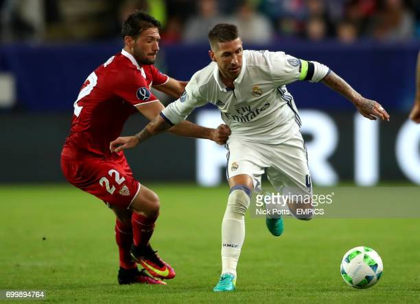 Real Madrid's Sergio Ramos and Sevilla's Franco Vazquez battle for the ball