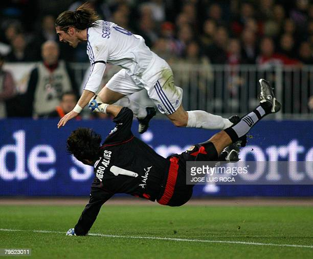 Real Madrid's Sergio Ramos crashes into Almeria's goalkeeper Diego Alves during a Spanish league football match at the Mediterraneo Stadium in...