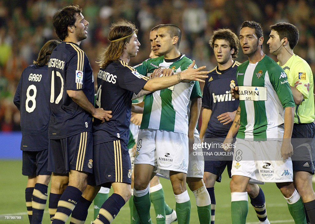 Real Madrid's Sergio Ramos gets in an altercation with Betis's Melli during a Spanish league football match at the Ruiz de Lopera stadium in Sevilla...