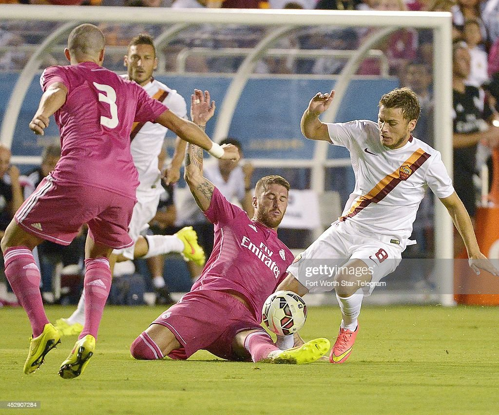 Real Madrid's Sergio Ramos stops AS Roma 's Adem Ljajic, right, in the Guinness International Champions Cup at the Cotton Bowl in Dallas on Tuesday, July 29, 2014.