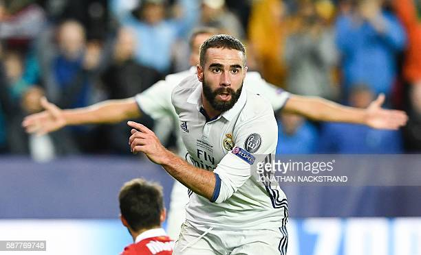 Real Madrid's Spanish defender Dani Carvajal celebrates after scoring the 32 goal at overtime during the UEFA Super Cup final football match between...