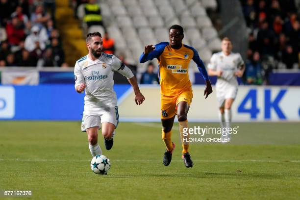 Real Madrid's Spanish defender Dani Carvajal dribbles past Apoel's Brazilian midfielder Vinicius during the UEFA Champions League Group H match...