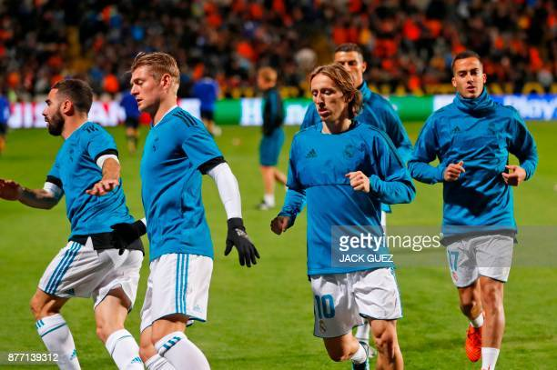 Real Madrid's Spanish defender Dani Carvajal German midfielder Toni Kroos Croatian midfielder Luka Modric Portuguese forward Cristiano Ronaldo and...