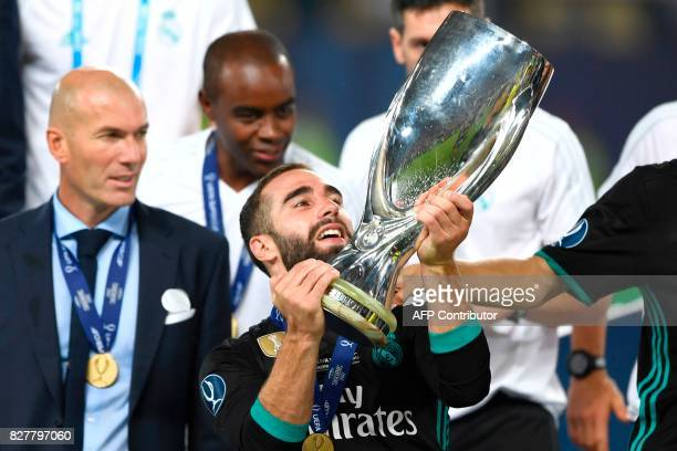 Real Madrid's Spanish defender Dani Carvajal holds the trophy after winning the UEFA Super Cup football match between Real Madrid and Manchester...