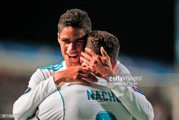 Real Madrid's Spanish defender Nacho celebrates his goal with Real Madrid's French defender Raphael Varane during the UEFA Champions League Group H...