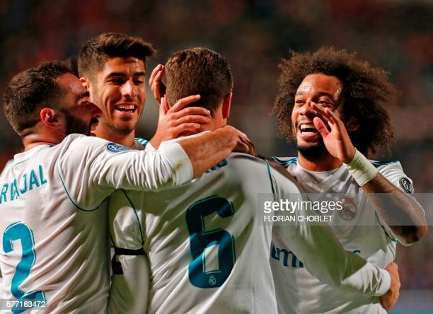 Real Madrid's Spanish defender Nacho celebrates his goal with Spanish defender Dani Carvajal Spanish midfielder Marco Asensio and Brazillian defender...