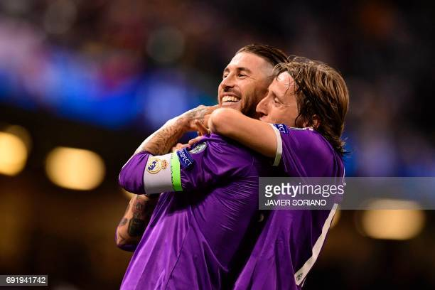 TOPSHOT Real Madrid's Spanish defender Sergio Ramos and Real Madrid's Croatian midfielder Luka Modric celebrate after Real score their fourth goal...