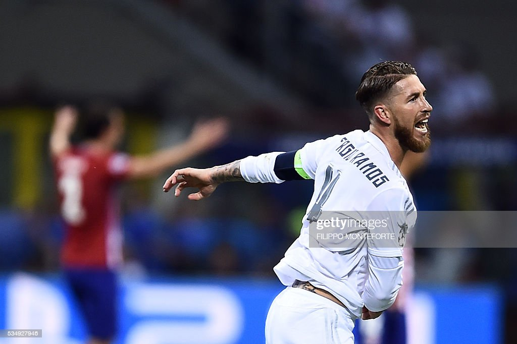 Real Madrid's Spanish defender Sergio Ramos celebrates after scoring a goal during the UEFA Champions League final football match between Real Madrid and Atletico Madrid at San Siro Stadium in Milan, on May 28, 2016. / AFP / FILIPPO
