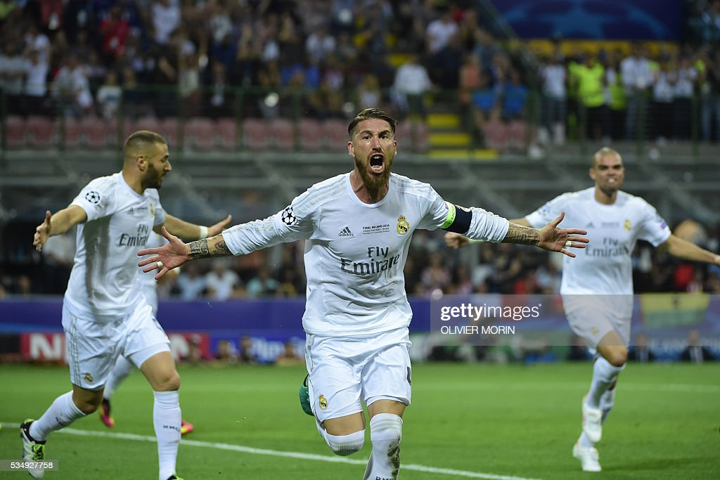 Real Madrid's Spanish defender Sergio Ramos (C) celebrates after scoring the opening goal during the UEFA Champions League final football match between Real Madrid and Atletico Madrid at San Siro Stadium in Milan, on May 28, 2016. / AFP / OLIVIER