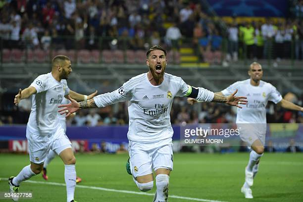 Real Madrid's Spanish defender Sergio Ramos celebrates after scoring the opening goal during the UEFA Champions League final football match between...