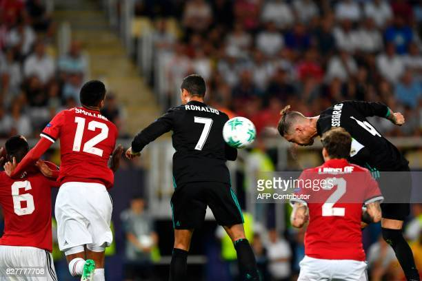 Real Madrid's Spanish defender Sergio Ramos heads the ball during the UEFA Super Cup football match between Real Madrid and Manchester United on...
