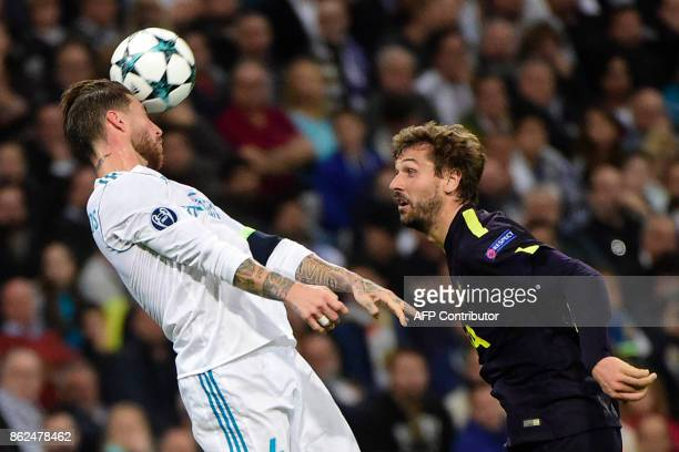 Real Madrid's Spanish defender Sergio Ramos heads the ball next to Tottenham Hotspur's Spanish striker Fernando Llorente during the UEFA Champions...