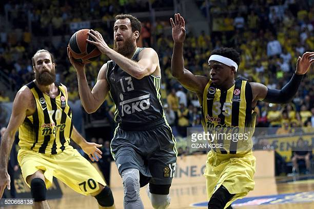Real Madrid's Spanish guard Sergio Rodriguez challenges Fenerbahce's Italian forward Luigi Datome and US guard Ali Muhammed during the Euroleague...