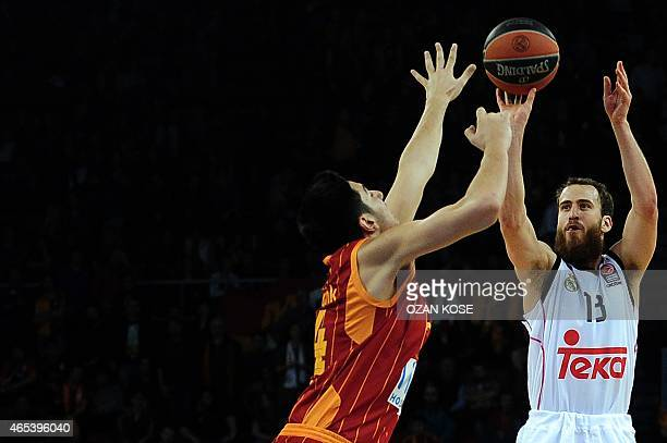 Real Madrid's Spanish guard Sergio Rodriguez challenges Galatasaray's Turkish forward Ege Arar during the Euroleague top 16 basketball match between...