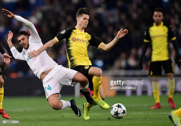 Real Madrid's Spanish midfielder Daniel Ceballos vies with Dortmund's German midfielder Julian Weigl during the UEFA Champions League group H...